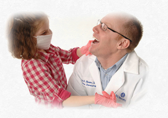 Dentist Dr. Jeff Heister with child